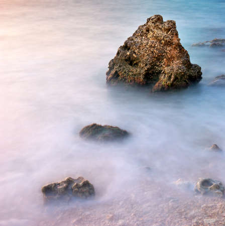 Beautiful seascape  Sea and rock at the sunset photo