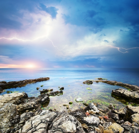 ocean storm: Rocks and sea storm. Dramatic scene. Composition of nature  Stock Photo