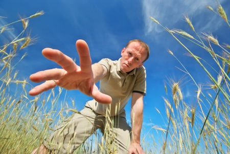 Man find some in grass Stock Photo - 21648374