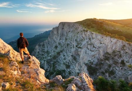 Man on top of mountain. Conceptual design. Standard-Bild