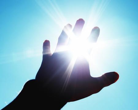 Hand to sun. Element of design. Stock Photo