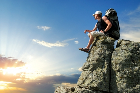Tourist in mountain Standard-Bild