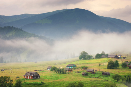 Village in mountain. Nature composition. photo