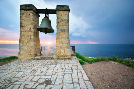church bells: Big bell on sea shore. Nature composition.