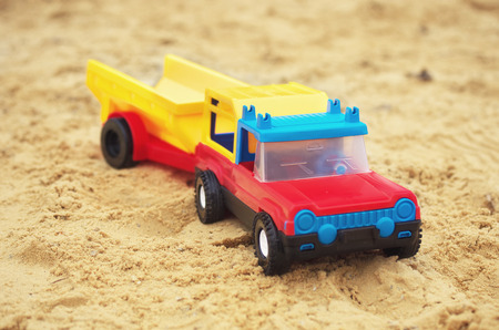 Toy car on sand. Element of design. photo