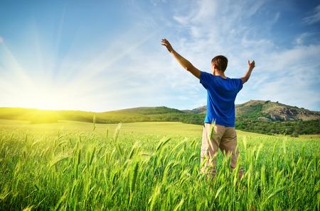 Man in green meadow. Emotional scene. Stock Photo - 27214532