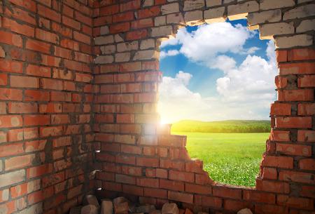 broken through: Broken bricks wall. Conceptual composition.