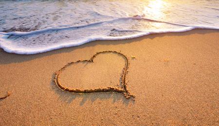 heart in sand: Heart on beach. Romantic composition.