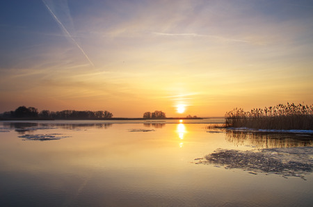 Sunrise on river. Nature composition. photo