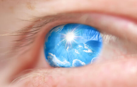 expectations: Sky into the eye. Conceptual design. Shallow depth-of-field. Stock Photo