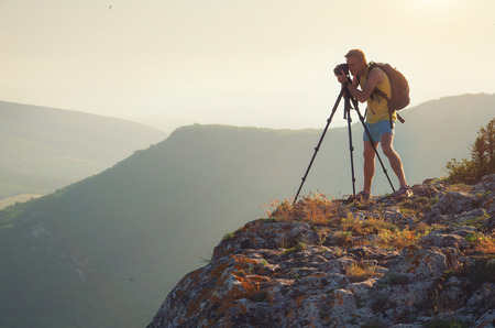 Photograph work in mountain. Job scene.