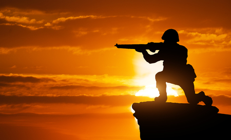 sniper training: Silhouette of soldier on the edge. Element of design.