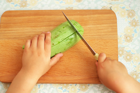 vegetus: Child help preparing food. Eleemnt of design.