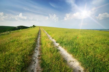 single lane road: Road lane and deep blue sky. Nature design.