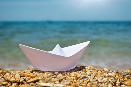 Origami ship on the sea. Stock Photo