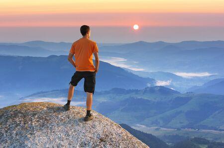 success man: Man on peak of mountain. Element of design.