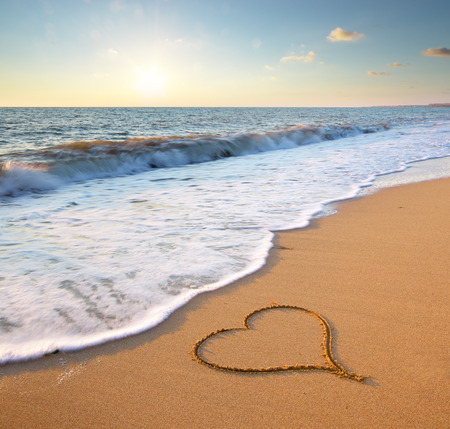 romantic beach: Heart on beach. Romantic composition.