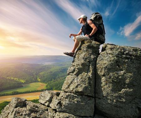 rucksack ': Man on peak of mountain. Stock Photo