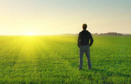 freedom: Man in meadow green meadow. Conceptual scene. Stock Photo