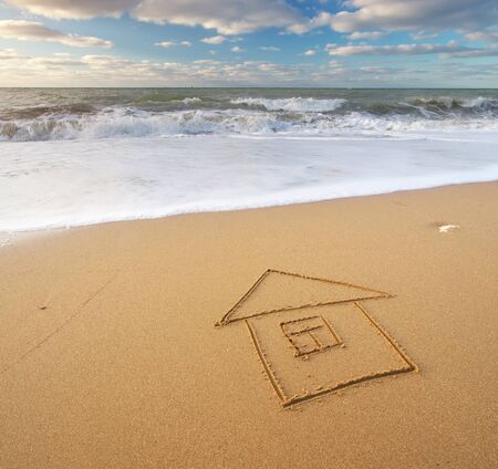 draw: Sea and home on the sea sand. Nature and conceptual composition.