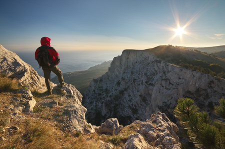 top mountain: Man on top of mountain. Conceptual design. Stock Photo
