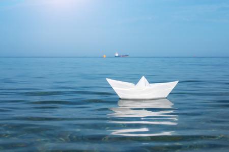 Paper toy ship and deep blue sea. Conceptual design. Reklamní fotografie