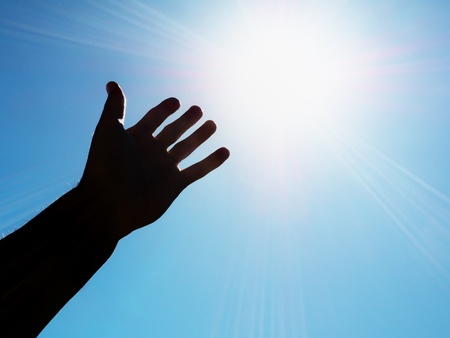 Hand to sun. Element of design. Stock Photo