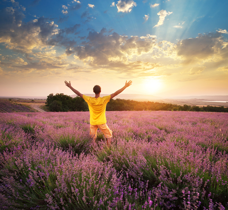 Man in meadow of lavender. Emotional scene. photo