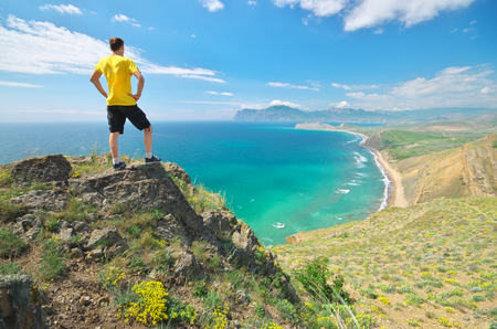 Man enjoy the nature landscape. Sea and mountain. photo