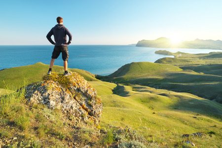 Man enjoy the nature. Sea and mountain. photo