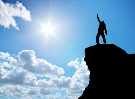 Man on top of mountain. Conceptual design. photo