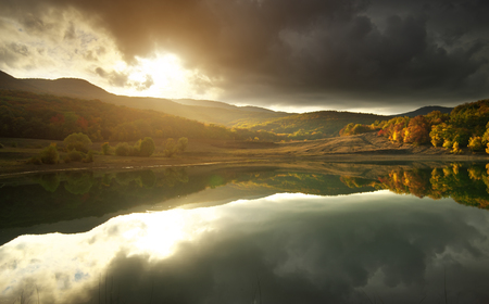 Sunshine on the lake. Nature composition.