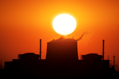 tall chimney: Power plant on the sunset. Big sun and energy industry.
