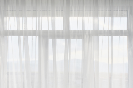White tulle on window. Interior design.