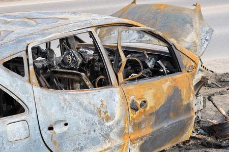An abandoned, stolen burnt out car Stok Fotoğraf