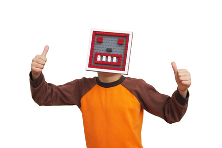 Portrait of little boy with robot head giving you thumbs up over. Conceptaul scene. Stock fotó