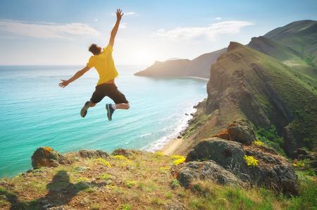 Man happines jump and sea. Emotional scene.