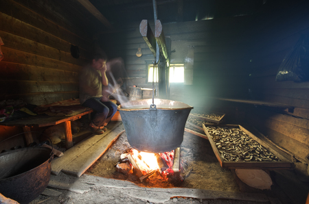 Big pan copper kettle in hermitage. Hermit cooking into old house.