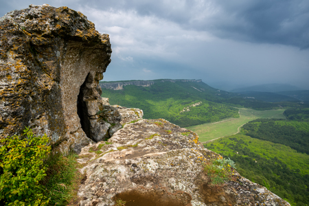 Mountain old ruin cave town Mangup after the rain. Nature landscape composition.