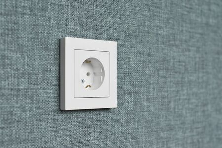 Wall socket on the wall. After repair scene. Shallow depth-of-field