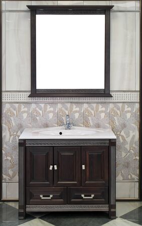 White vanity sink top with sink and a stylish mirror in bathroom interior.