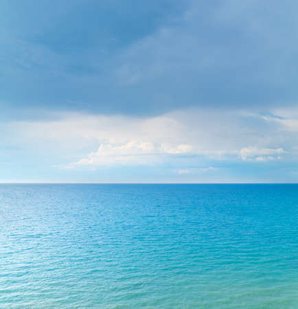 Cloudy sky and sea. Nature background view. Фото со стока