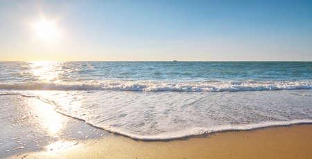 Sandy seashore at sunset. Nature composition. Фото со стока