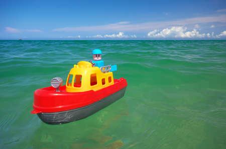 Toy ship boat and sea wave. Conceptual design. Фото со стока