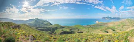 Sea bay panorama. Natural landscape. Spring mountain and sea shore. Фото со стока