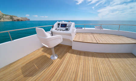 Ocean calm water view from yacht flybridge open deck, modern and luxury equipped with navigation dashboard devices. Lifestyle freedom concept. Foto de archivo