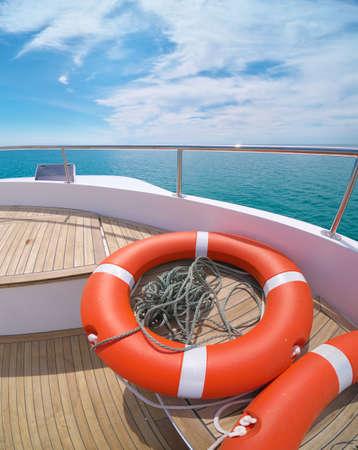 Lifebuoy on the yacht deck. Recreation on sea travel. Фото со стока
