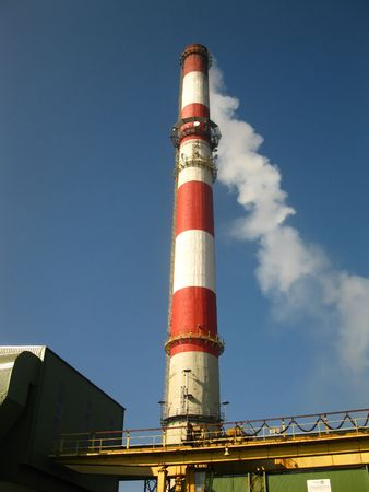 exhaust gases: red and white chimney with outgoing exhaust gases or steam