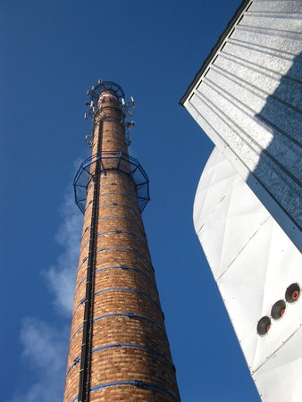 old brick chimney in the blue sky Stock Photo - 8914130