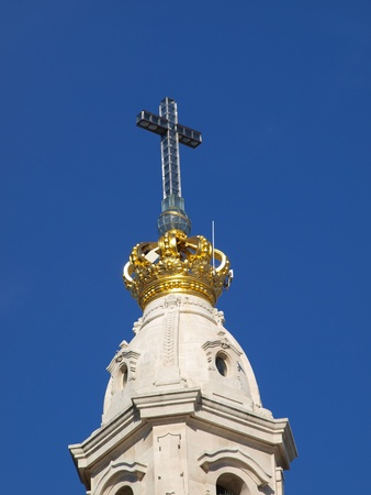 gold crown on the tower of the basilica of the Rosary of Fatima in Portugal photo
